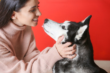 Portrait of young woman with her cute husky dog