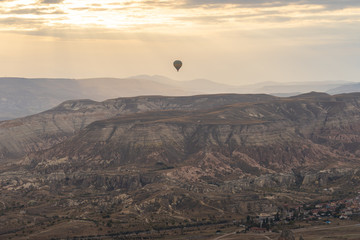 Wall Mural - Cappadocia skyline with hot air bollon riding in Cappadocia, Turkey.