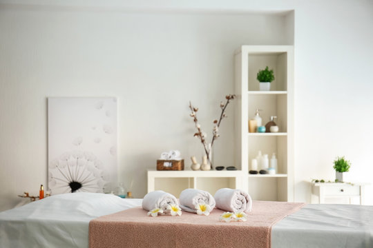 Soft towels on table in spa salon