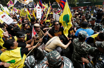 Tibetans scuffle with police during a protest demanding that the United Nations (UN) urgently heed to the unresolved issues of Tibet outside the UN office in New Delhi
