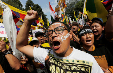 Tibetans shout slogans during a protest demanding that the United Nations (UN) urgently heed to the unresolved issues of Tibet outside the UN office in New Delhi