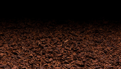 Grated chocolate texture. Ground chocolate background