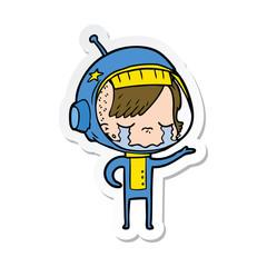 sticker of a cartoon crying astronaut girl