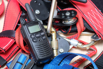 on the table are the radio and equipment for rescue climbers and industrial mountaineering