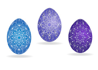 Easter eggs in blue and violet colors with an openwork white pattern. Vector