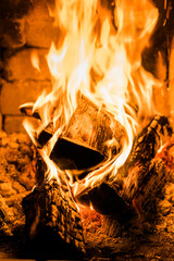 Fireplace and burning firewood. Traditional heating