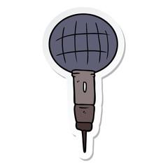 sticker of a cartoon microphone