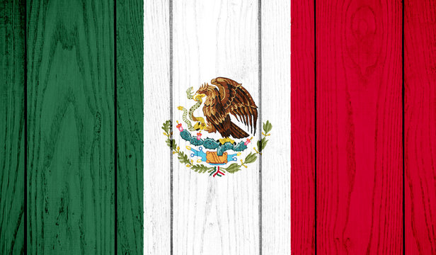 Flag of Mexico on wooden background