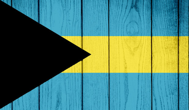 Flag of The Bahamas on wooden background