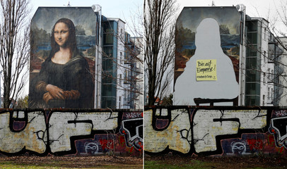 "A combination picture shows a mural by Berlin-based street art gang ""Die Dixons"" (The Dixons) which features a giant reproduction of Leonardo da Vinci's artwork Mona Lisa and a post-it painted on the blank figure site"
