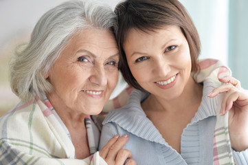 Portrait of cute senior woman with daughter