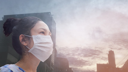 women wearing facial hygienic mask for Safety outdoor. People in masks because of fine dust in...
