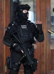 Belgian special unit police officer secures the Palace of Justice during the trial of Mehdi Nemmouche and Nacer Bendrer in Brussels