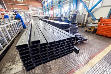A bundle of metal rectangular profile. Industrial interior