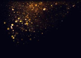 glitter vintage lights background. gold and black. de focused Wall mural