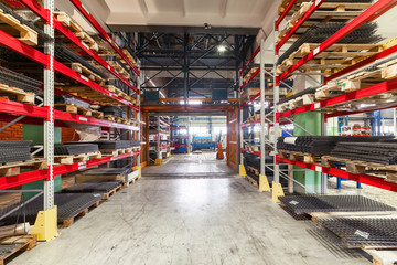 Factory warehouse steel reinforcement. High stacked shelving.