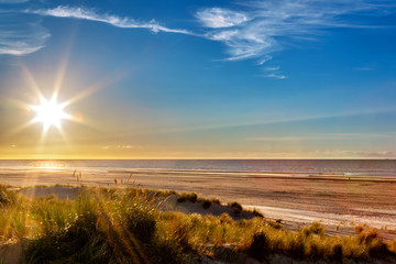 Wall Mural - Sunset at the beach on the East Frisian Island Juist in the North Sea, Germany.