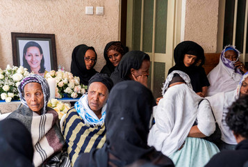 Relatives and friends of Sara Gebremichael, a senior hostess and a crew leader on the Ethiopian Airlines Flight ET 302 plane that crashed, mourn at her house in Addis Ababa