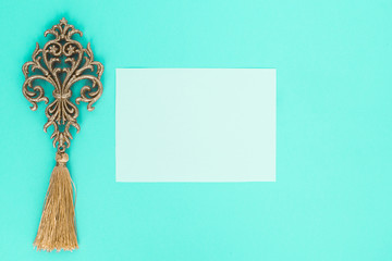 flatley on turquoise background with white paper sheet for text and fern leaves,  top view, space for text, copy space,