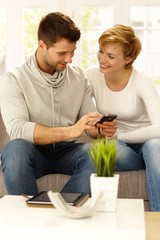 Happy couple with mobile