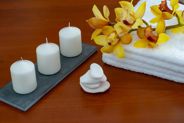 towels candles stones and orchid