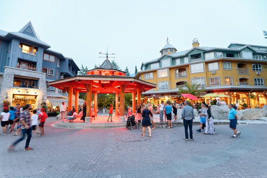 WHISTLER, CANADA - AUGUST 12, 2017: Tourists enjoy city center on a summer night. Whistler is a famous mountain destination in British Columbia