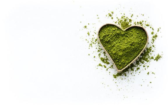 Tea matcha powder on a white background, top view. Love matcha