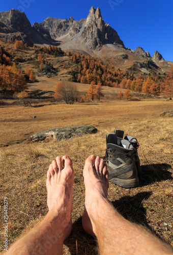 Fotomurales Feet of a hiker relaxing in the sun in the French Alps. Vallee de la Claree, Nevache.