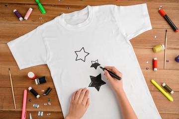 Woman drawing black stars