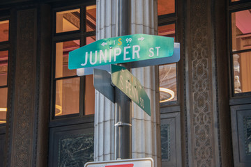 Juniper Street and South Penn Square street signs on pole in center city Philadelphia