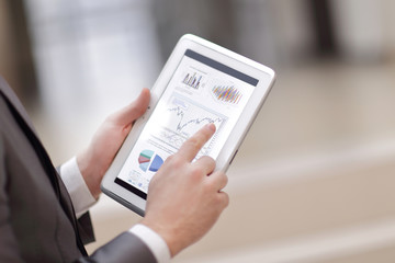 Close up of Man's hands working with digital tablet, Financial