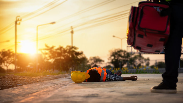 Accident at work of construction labor people, Basic First aid and CPR Training at outdoor. Heat Stroke or Heat exhaustion in body concept.