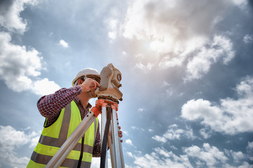 Fototapeta Surveyor equipment. Surveyor's telescope at construction site or Surveying for making contour plans are a graphical representation of the lay of the land before startup construction work