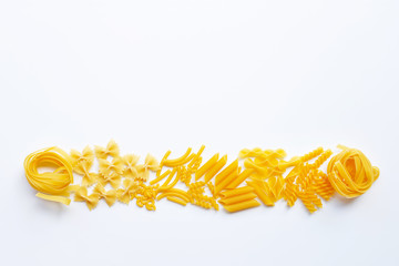 Different types of dry pasta on white.
