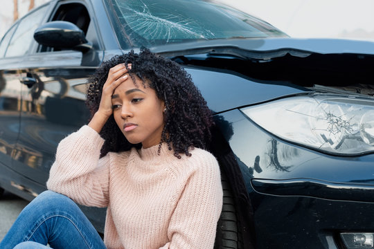 Car accident and black woman feeling pain