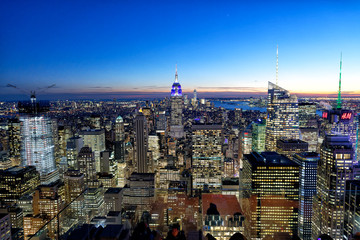 Wall Mural - NEW YORK CITY - DECEMBER 7, 2018: Manhattan aerial skyline at night. New York attracts 50 million tourists annually