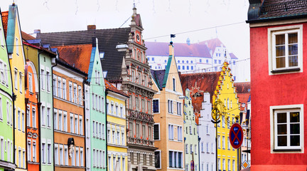 Fototapete - landmarks of Germany- Landshut town in Bavaria. View with traditional colorful houses and castle Trausnitz