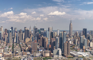 Amazing aerial view of New York City. Midtown Manhattan skyline from helicopter on a sunny afternoon