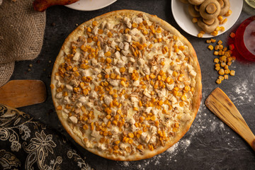 Pizza with chicken, mushrooms and sweet corn