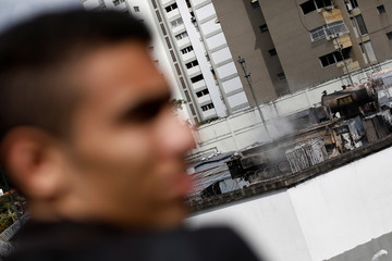 Smoke is seen on top of a burnt electrical substation after a massive blackout in Caracas