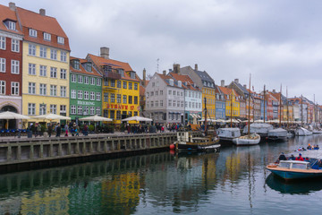 The colorful row of buildings along the waterfront at the Nyhavn district in Copenhagen