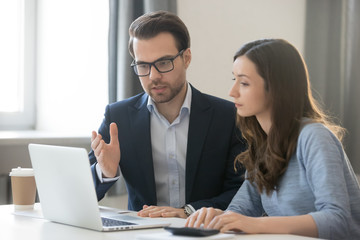Helpful boss mentor explaining new online project to worker intern