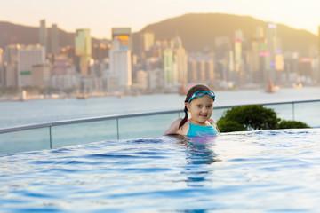 Kids swim in Hong Kong roof top swimming pool