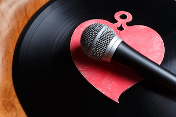 Song for lovers. Nostalgic songs, concept with vinyl records, microphone and heart