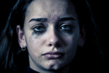 Portrait of sad, unhappy young girl crying. Helpless, depressed child. Stop bullying campaign
