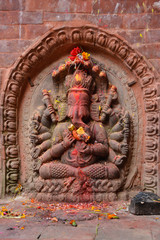Statue of Lord Ganesha decorated with flowers and fruits in Kathmandu, Nepal