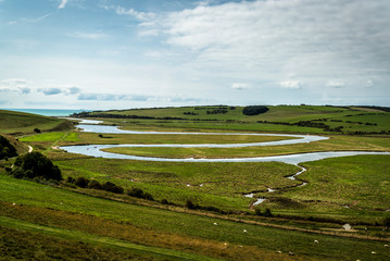 Cuckmere Haven, a meandering river forming several oxbow lakes, between Seaford and Eastbourne, East Sussex, England, UK