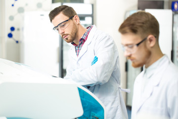 Two male scientists working at the laboratory