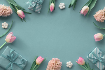 Springtime green and blue  background with pink tulips, hyacinth and spring decorations, copy-space