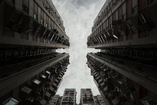 high rise building under grey sky
